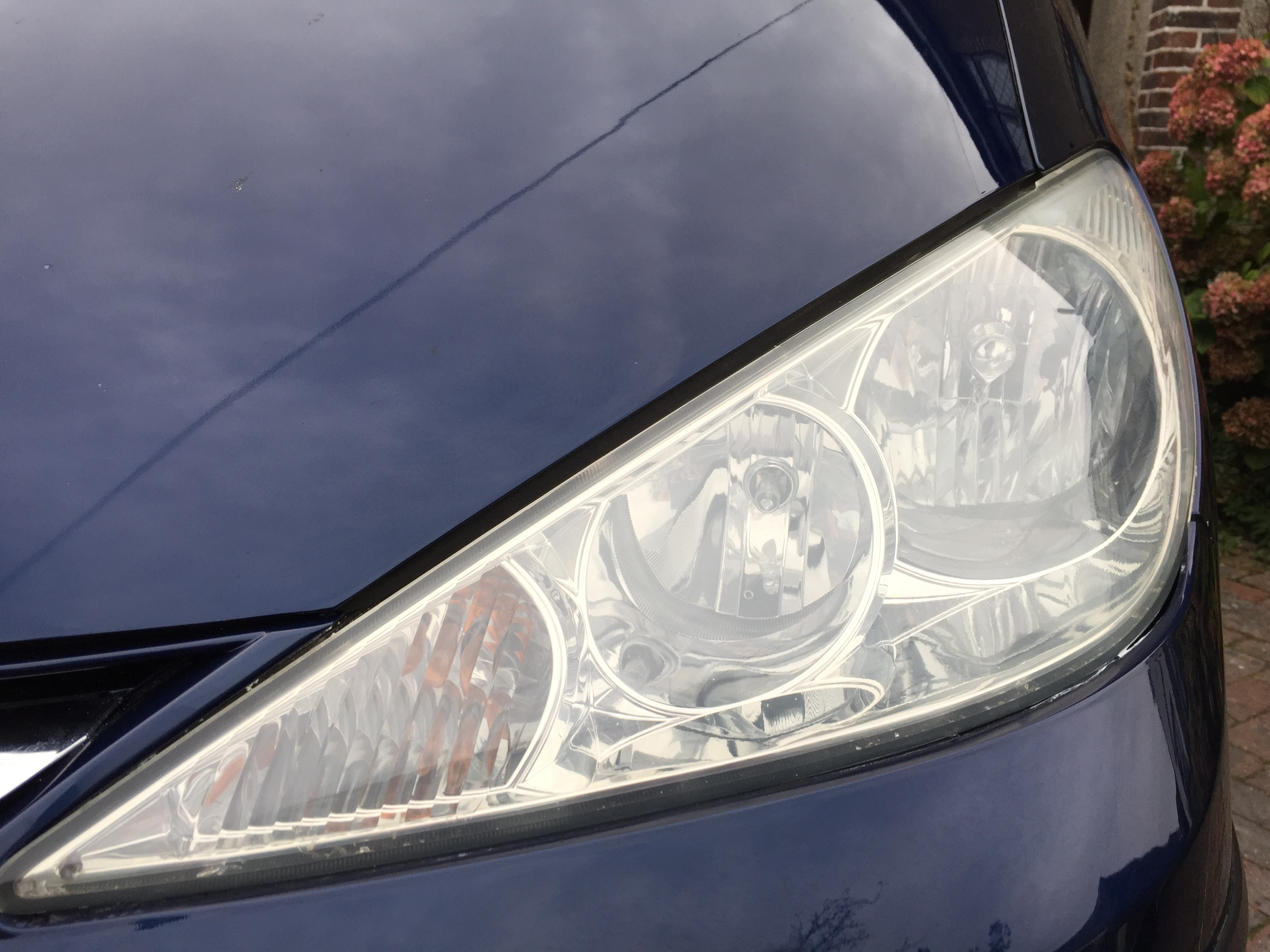 Shiny clear and sealed headlight after polishing.  Now a good MOT pass and makes your car look good.